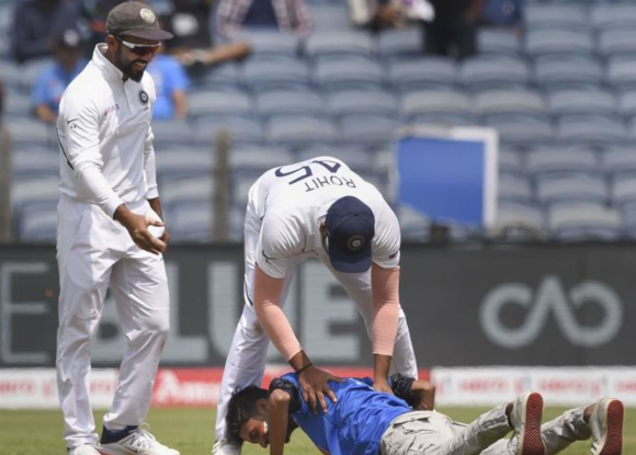 Watch: Fan invades pitch to touch Rohit Sharma's feet